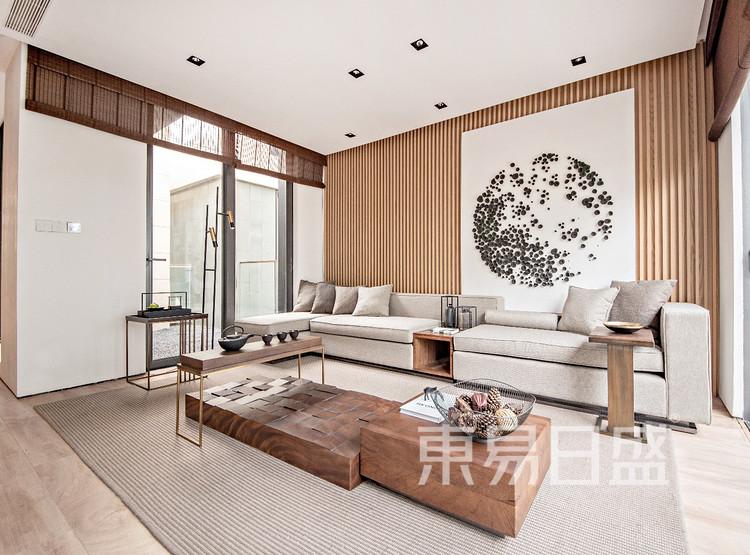 颜色自然过渡,协调统一,降低了对人们的视觉刺激,让空间更显高大挺拔。在沙发上选用禅意质感的棉麻布料,大画幅的立体侧向画纯粹而深思。